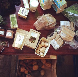 Lot's of local food displayed on a table.