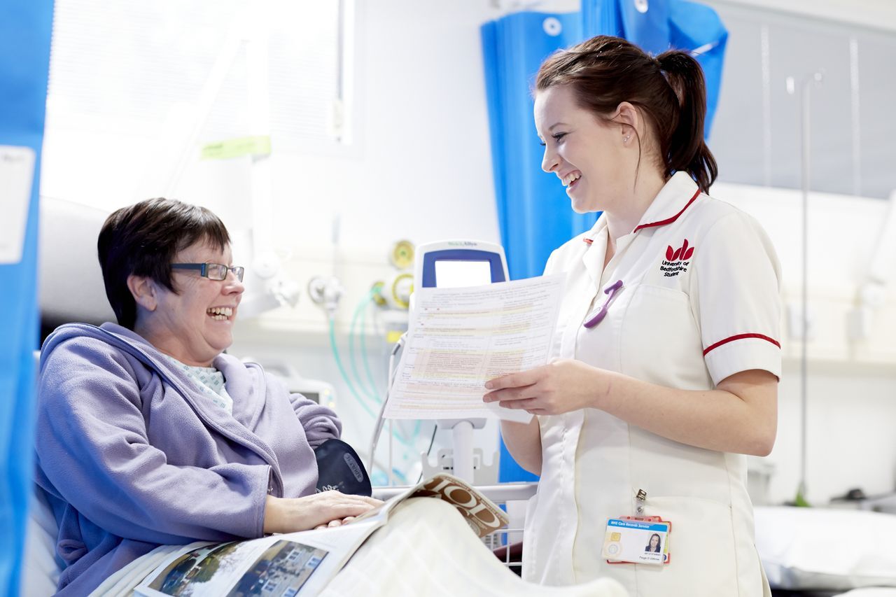 Nursing student talking to patient