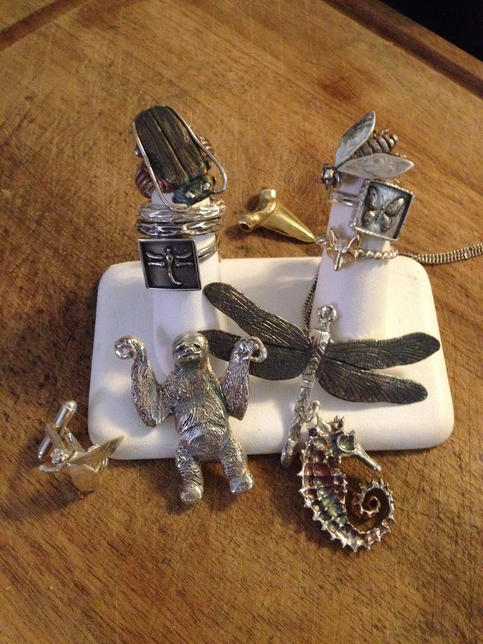 A selection of carved micro sculptural jewellery