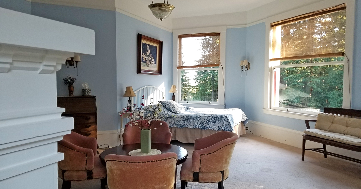 Master bedroom with private balcony, single historic accommodation