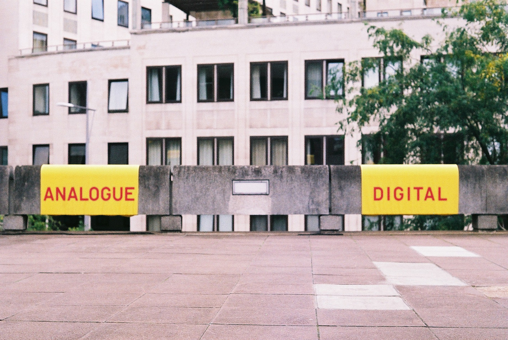 photo of plaza with signs reading analogue and digital