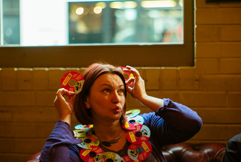 woman with beermat ears and necklace