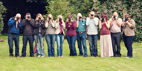 row of beginner photographers at a workshop.