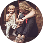 Lady sitting on doorstep with her daughter