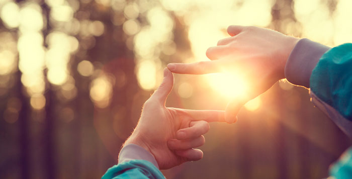 hands against the sunset