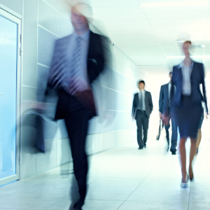 People walking down a corridor blurred.