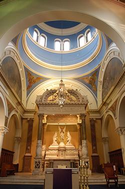 A grand church interior with a dome