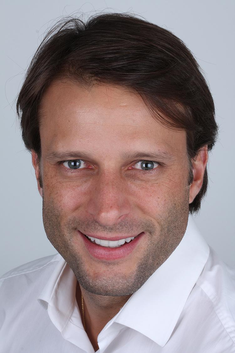 Dr. Christian Coachman