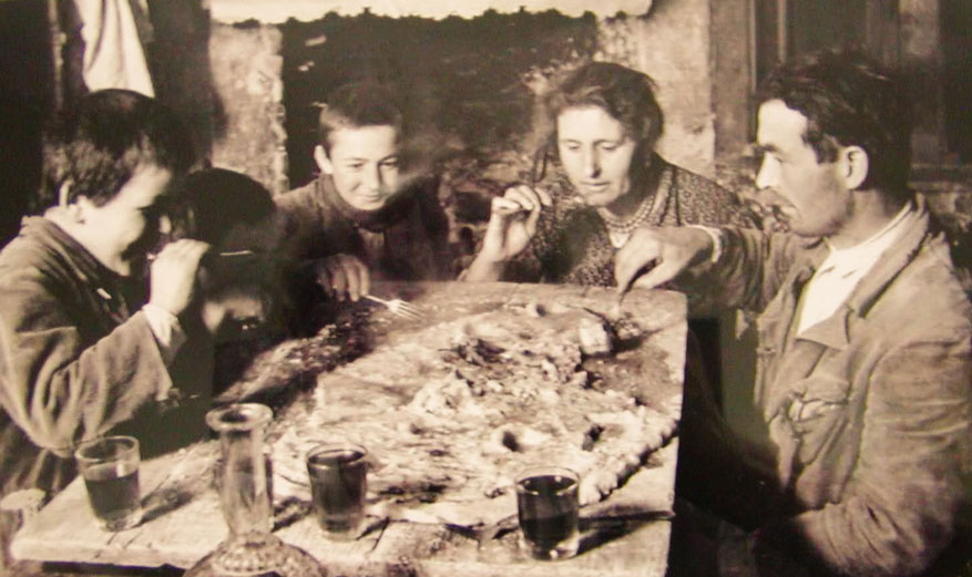 An Italian family enjoys the tradition of 'polenta sulla spianatora', a meal eaten straight from the table