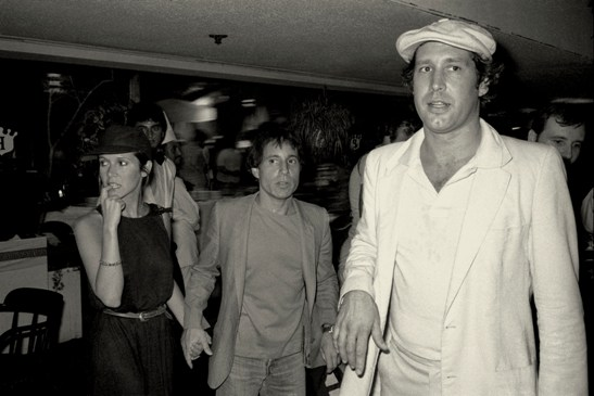 Gene Spatz, Chevy Chase, Paul Simon and Carrie  Fisher @ Caddyshack Premiere, 7/25/80. courtesy The Collection of Gene Spatz Photography, LLC.