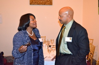The Honorable Sharon Barner learns about ChloroFill's proprietary building panels from CEO Michael Hurst