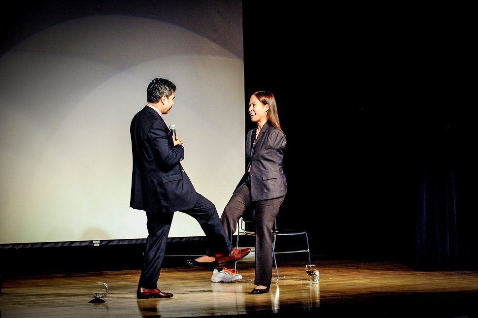 Jessica Cox and Diversity Programs Manager, Sal Morales greeting each other with a foot shake.