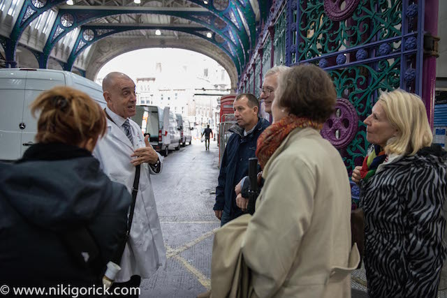 City Guide Peter Twist in the Grand Avenue with Group