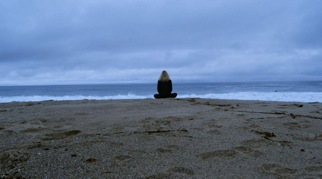 Liz Meditating on the Beach