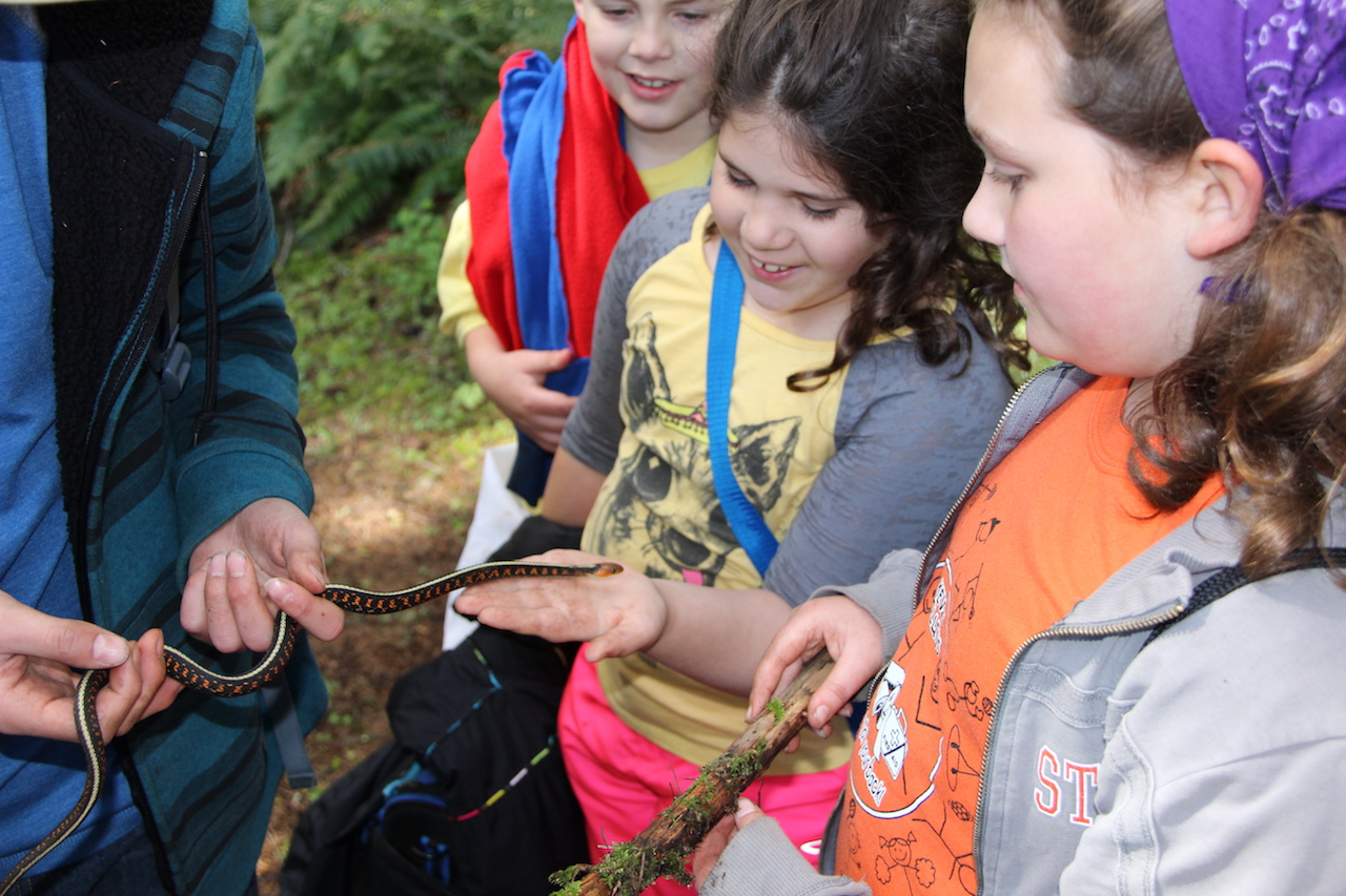 Children with garter snake