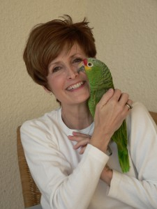 photo of Jean Hall with a parrot