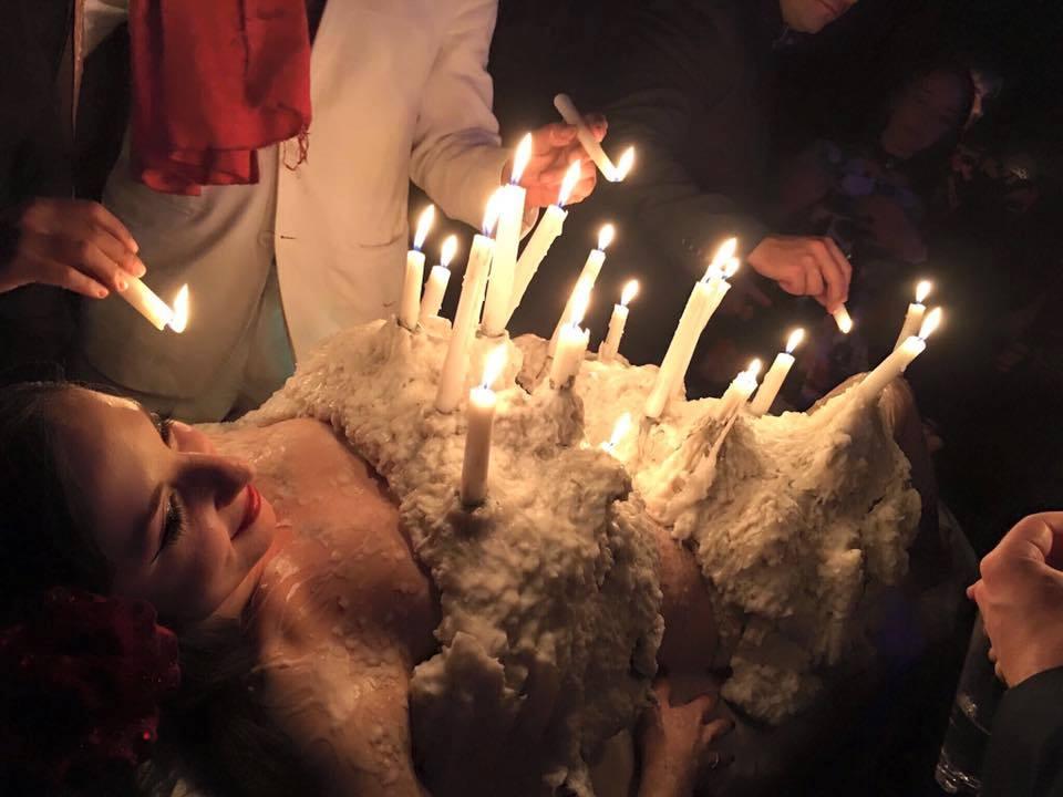 human candelabra featuring Sarah Sparkles