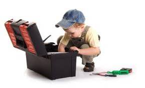 Little boy playing in toolbox