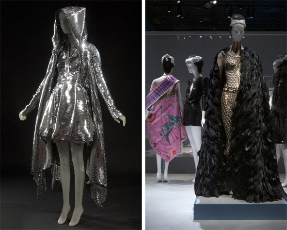 "From left: dress and hooded coat by Gareth Pugh; ensembles from the ""Sparkle"" section of the exhibition."