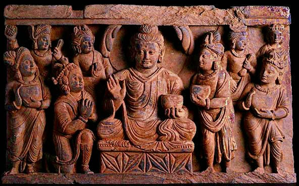 Stone carving of Buddha and his buddies