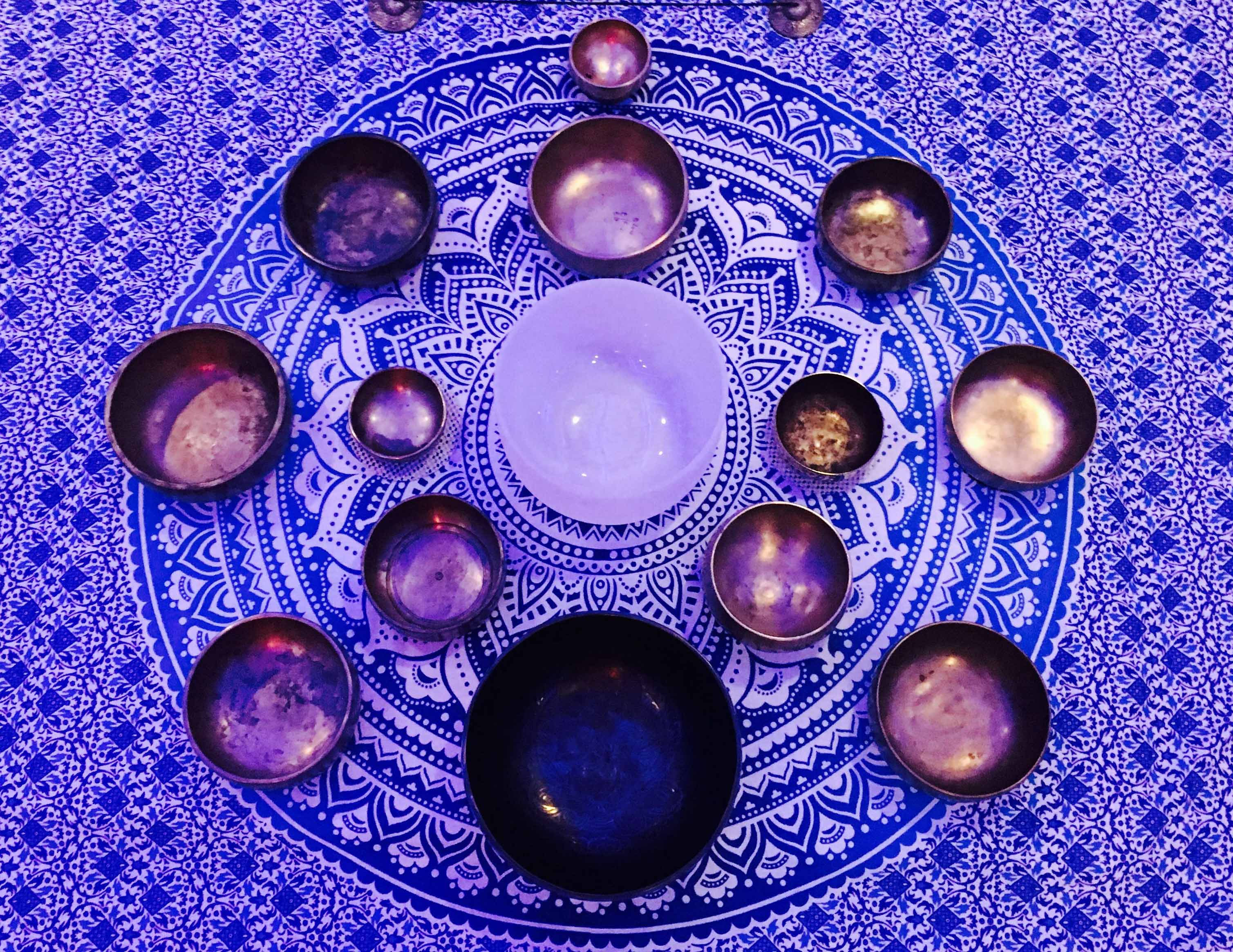 Tibetan Singing Bowls on purple cloth