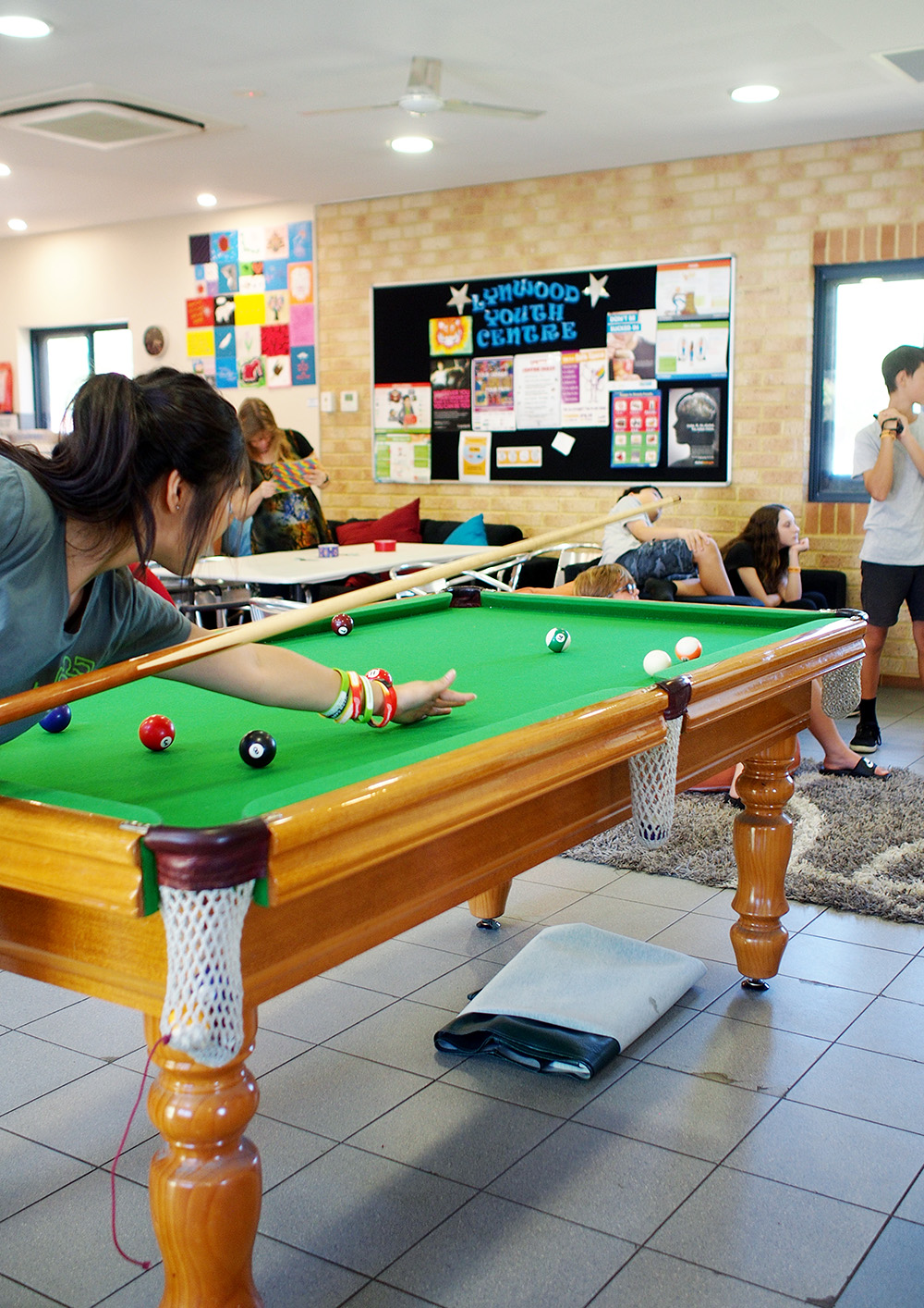 Picture of young people doing activities at a youth centre