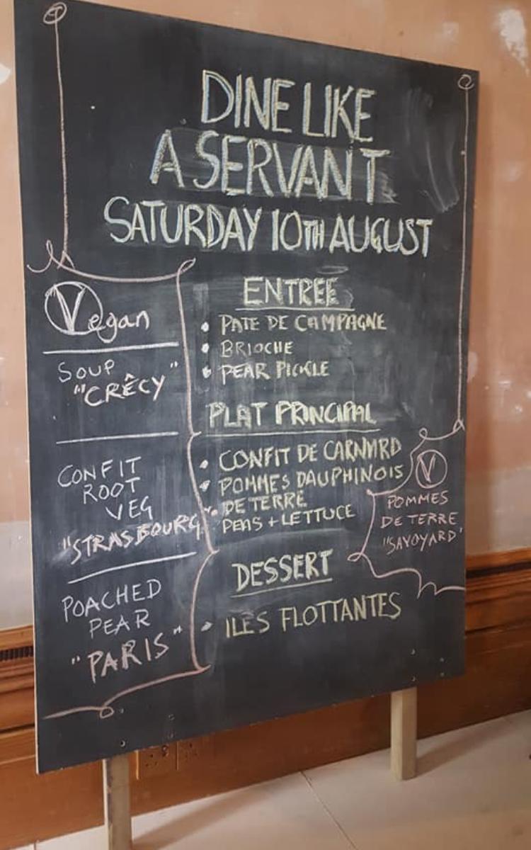 Blackboard featuring menu of Dine Like a Servant