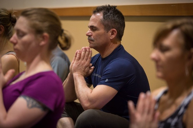 Man meditating at the Northwest Yoga Conference