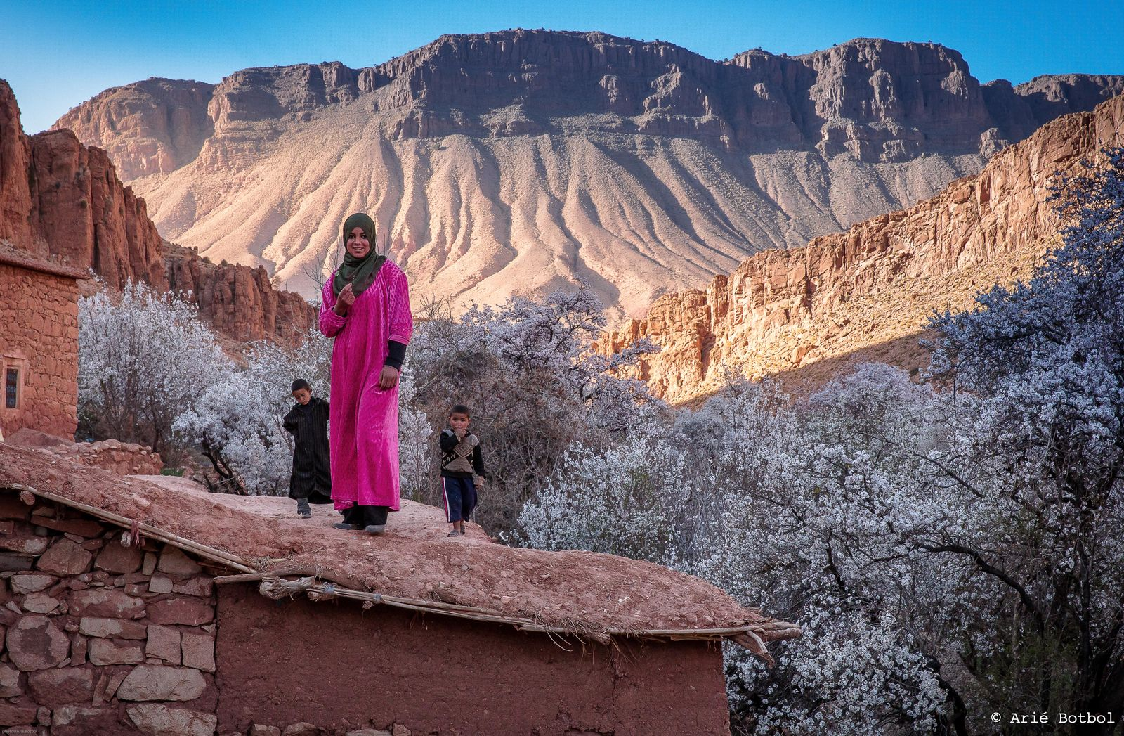 Girl on roof, Valley of the Roses High Atlas Morocco
