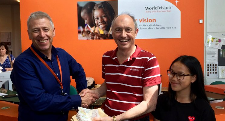 Mia and I making previous donation to World Vision