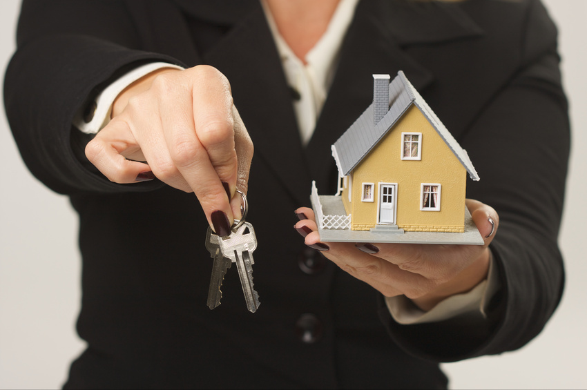 Woman handing over keys to new home