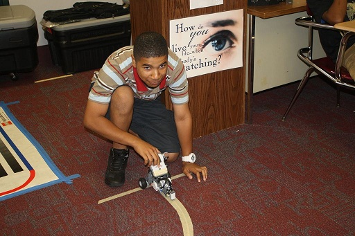Detroit Student programming the Robot