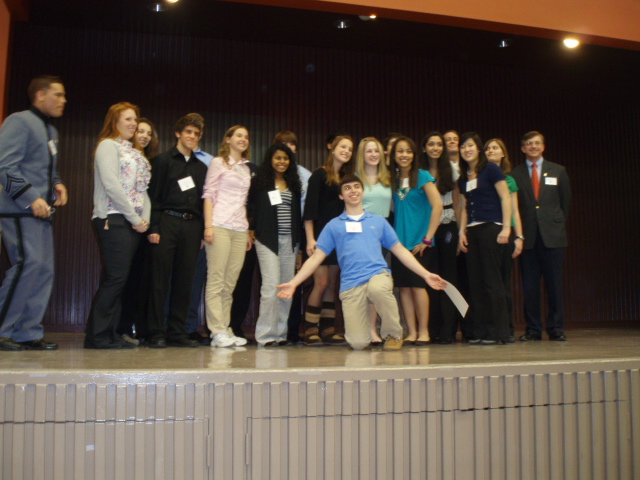 Students on stage after their presentation on ethics