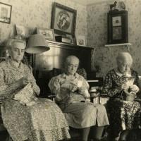 Black and white photograph of three women doing needlework