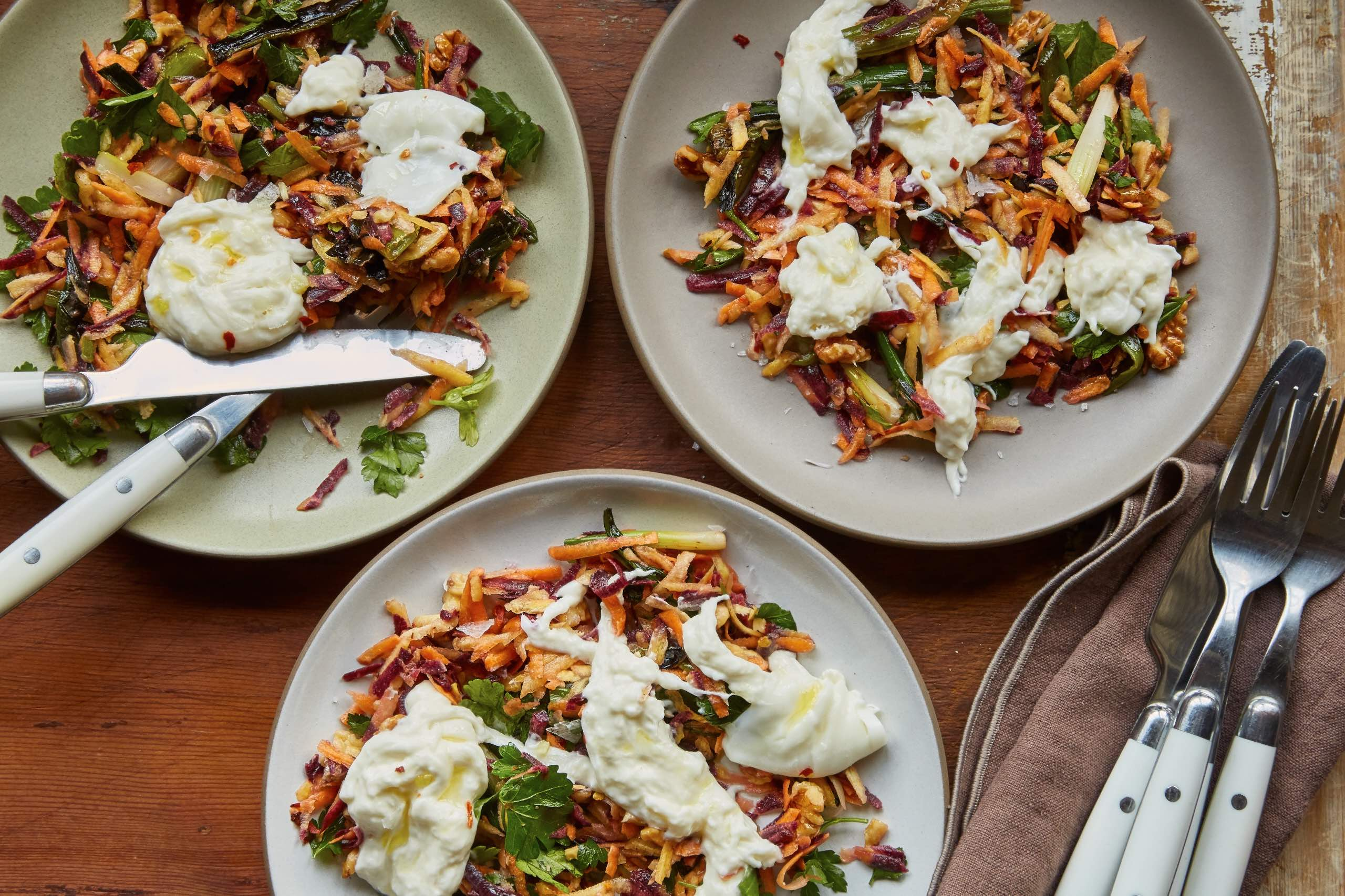 Grated carrot salad with grilled scallions, walnuts, and burrata