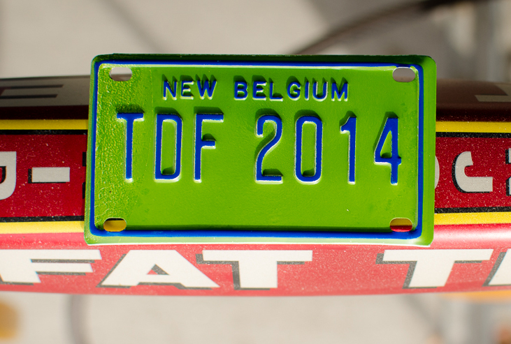 A city-specific TdF license plate or frog light included with any donation of at least $5
