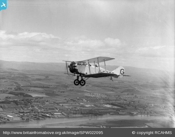 Bristol 89A Jupiter Biplane, registration G-EBQS, flying over Dalmuir, Clydebank. Oblique aerial photograph taken facing north.