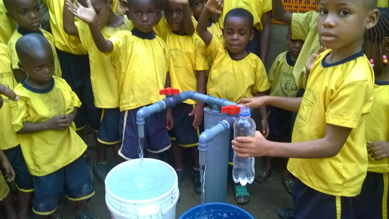 Happy school kids at a new well in Nigeria