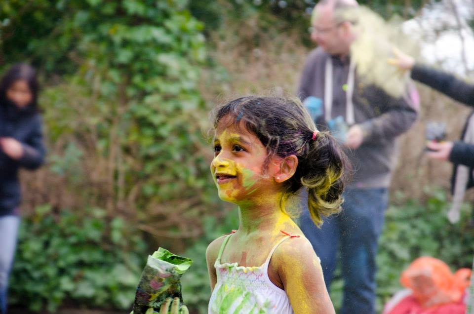 A Young Girl enjoys Holi festival