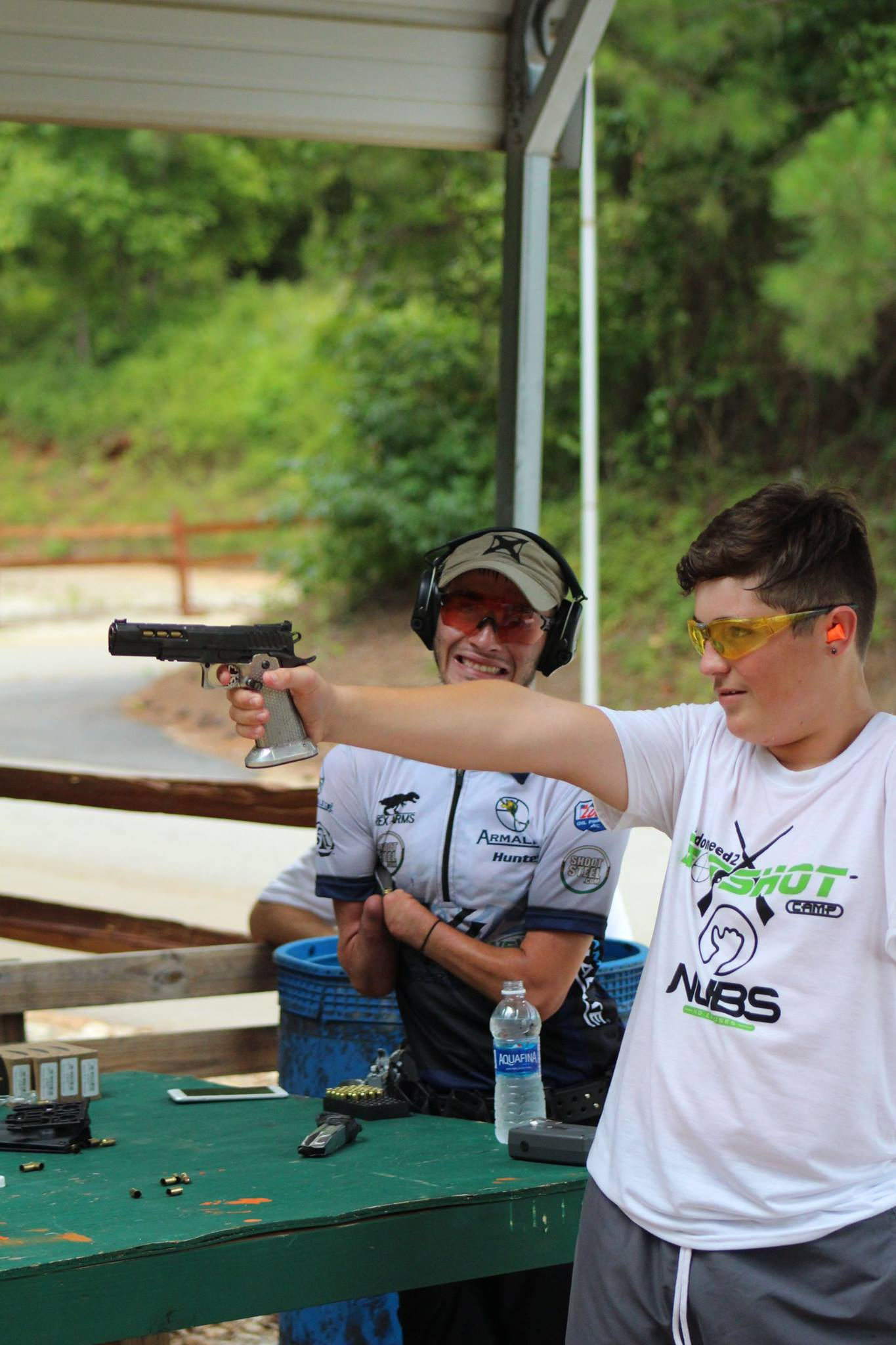 Hunter Cayll instructing how to target shoot with a pistol