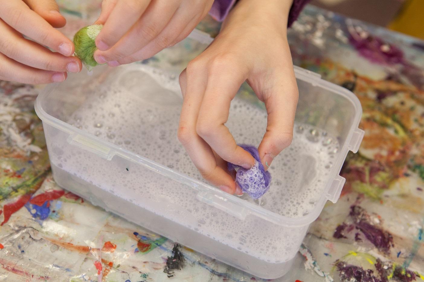 Kids hands in soap