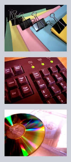 Vertical picture banner with coloured paper and binder clips, keyboard, and CD.