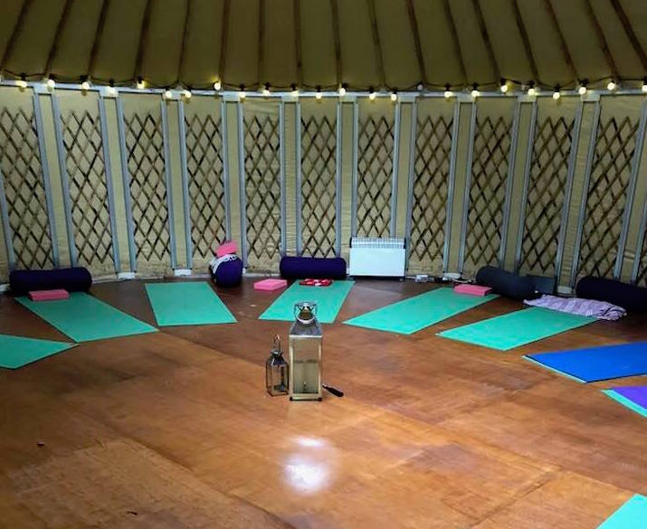 Yoga mats laid out in yurt ready for yoga day retreat