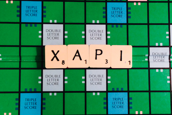 XAPI letters on a Scrabble board