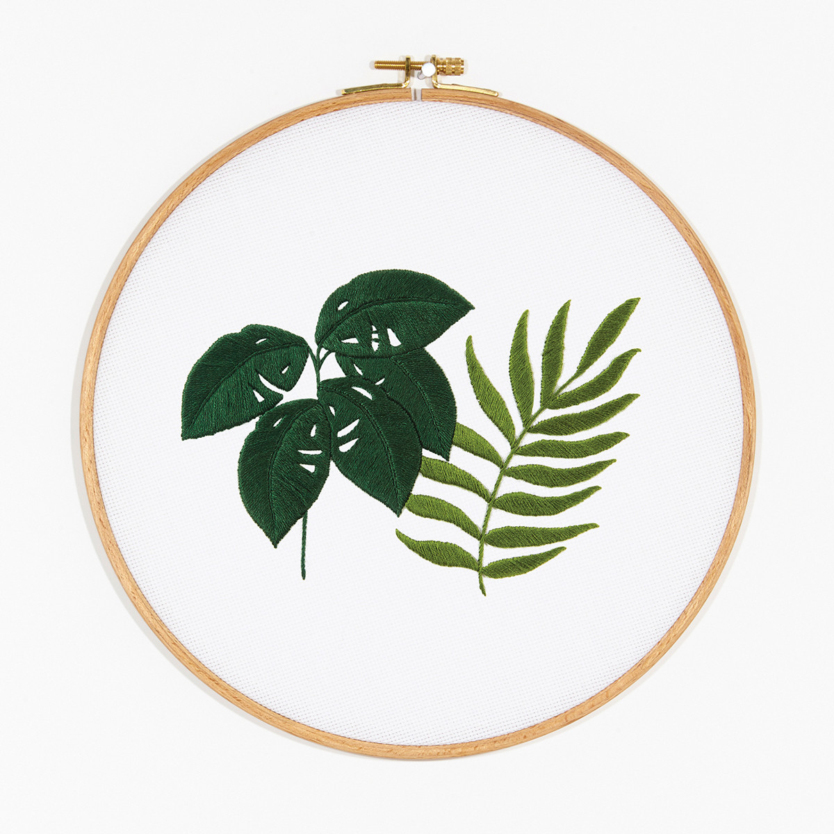 7 inch embroidery hoop showing montsera and fern embroidery design