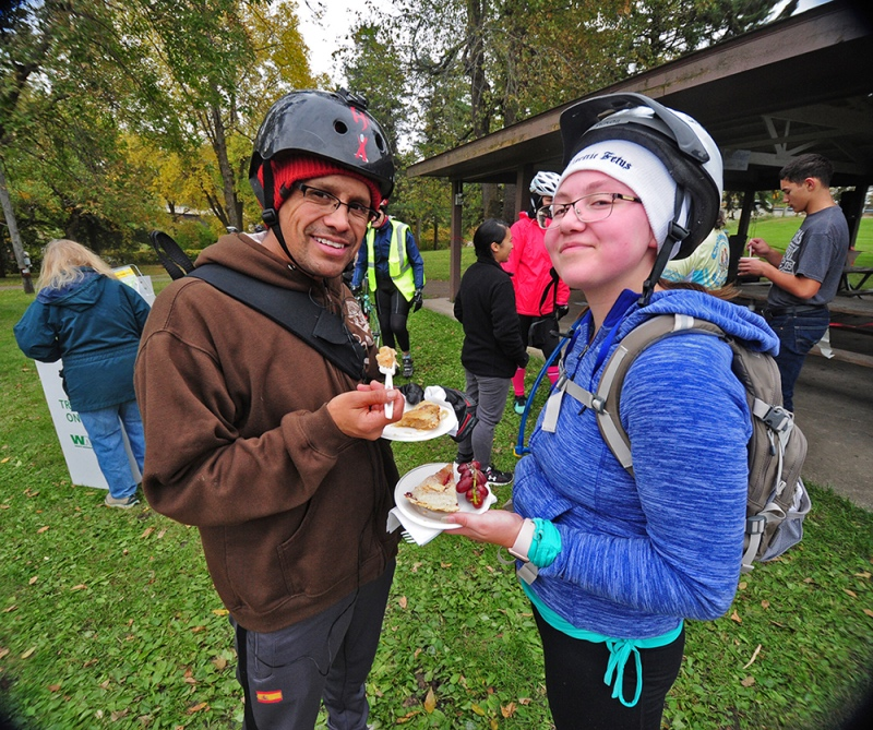 Two bicyclists enjoy slices of riverberry pie during the Mankato River Ramble Bike Tour.