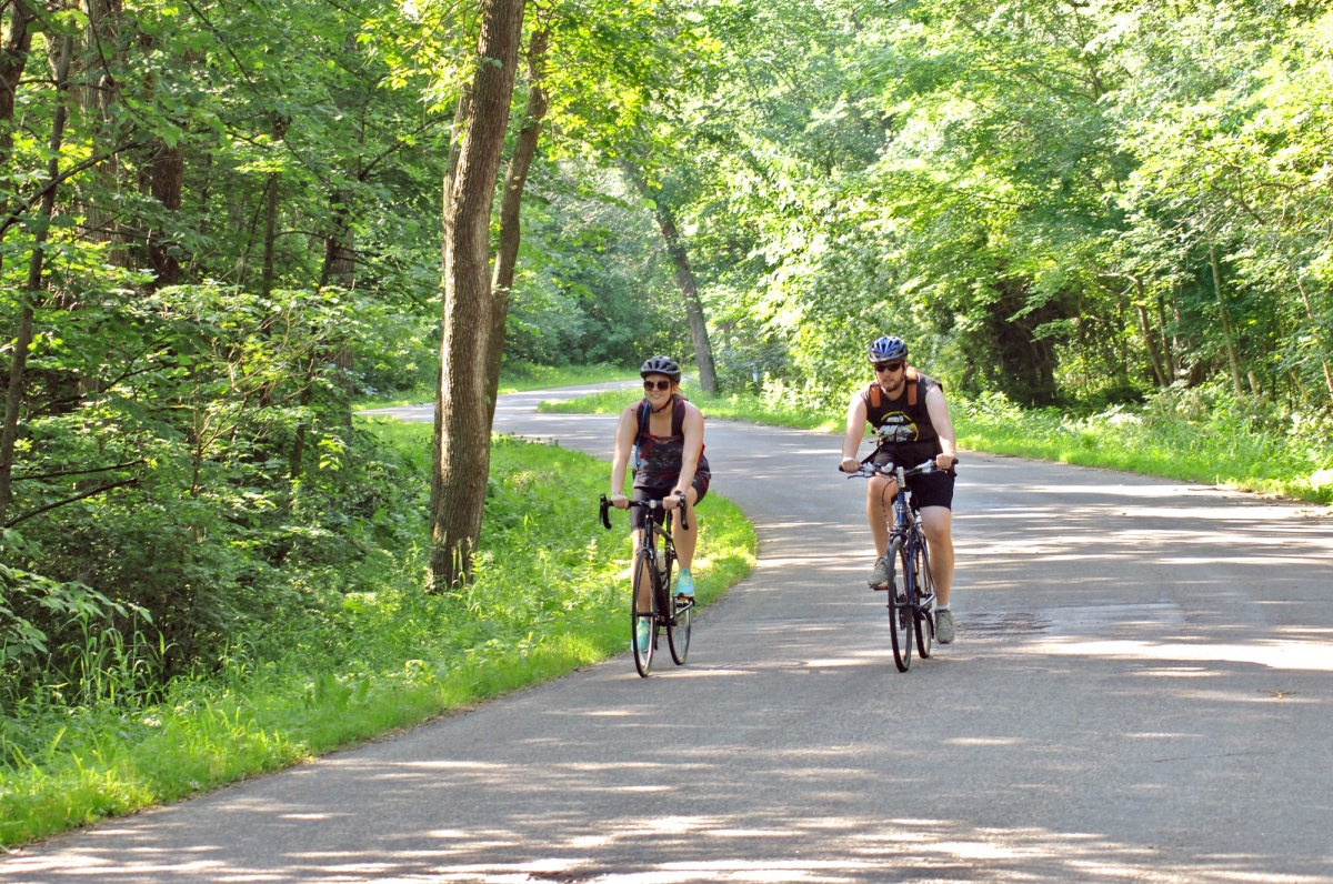 Two bicyclists ride through central Minnesota on the Tour of Saints