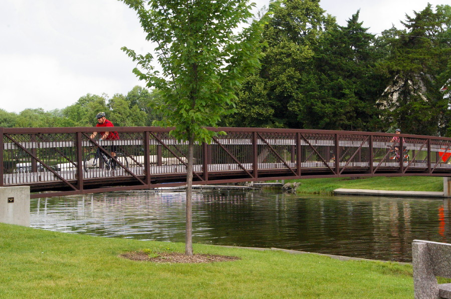 Two bicyclists ride across a bridge over Albert Lea Lake during the Rock-n-Roll the Lakes ride.
