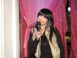 Tricia Cruz serving laughs at the MBar 9/6/11