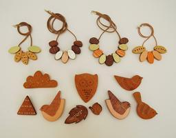decorated wooden birds and animals